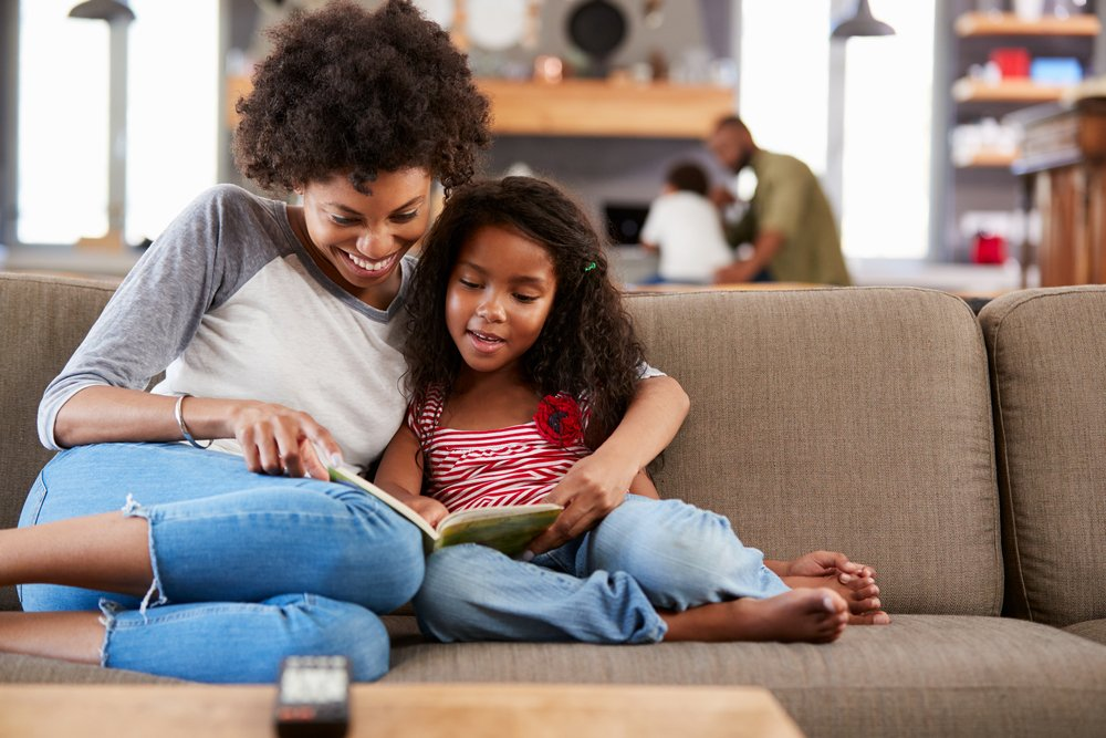 New Year's Resolutions To Make As A Family Read Together More